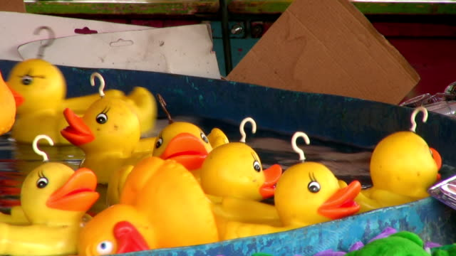 Hook a duck fairground sideshow game stall video