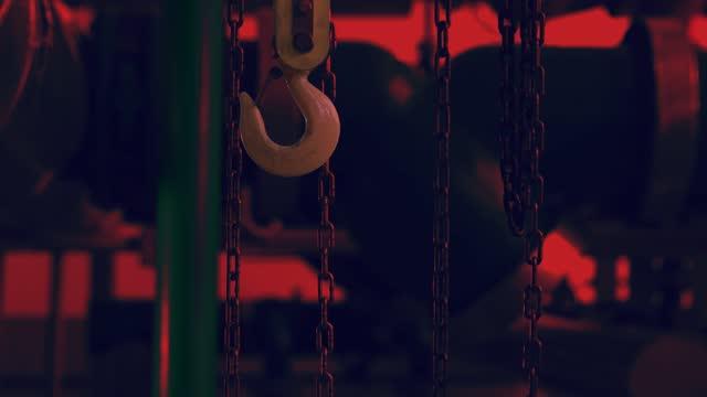 Hook and chains close-up hang at night