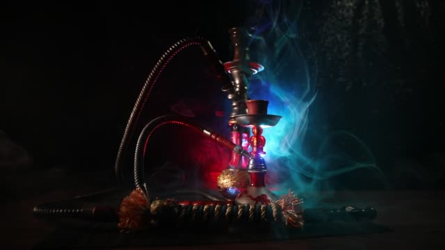 Hookah hot coals on shisha bowl on dark foggy background. Stylish oriental shisha. Creative concept Hookah hot coals on shisha bowl on dark foggy background. Stylish oriental shisha. Creative concept water pipe stock videos & royalty-free footage