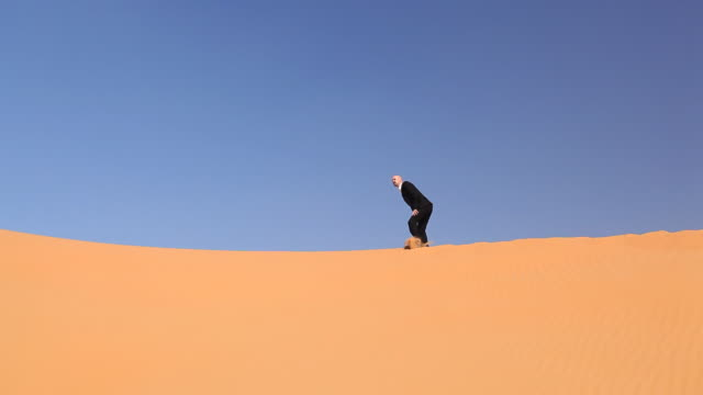 hopeless businessman in desert video