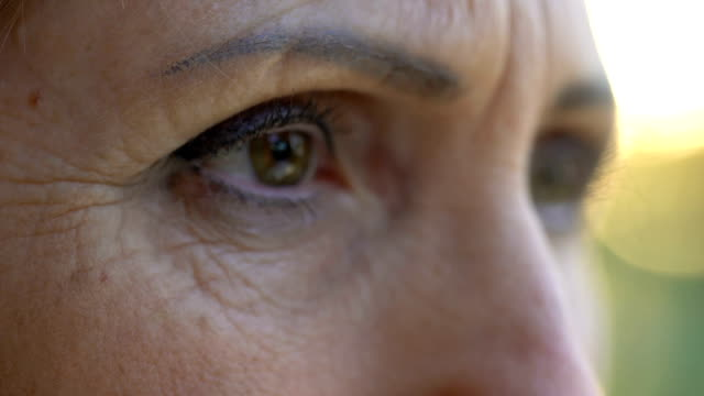 Hopeless senior woman looking into camera, worrying about future, close-up