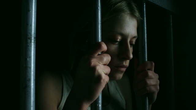 Hopeless women holding bars and looking through video