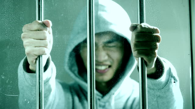 Hoping freedom,prisoner catch a steel cage in a cell Hoping freedom,prisoner catch a steel cage in a cell sentencing stock videos & royalty-free footage