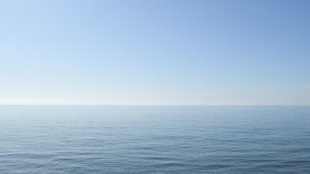 Horizon of blue calm sea with blue sky Horizon of blue calm sea with blue sky tranquility stock videos & royalty-free footage
