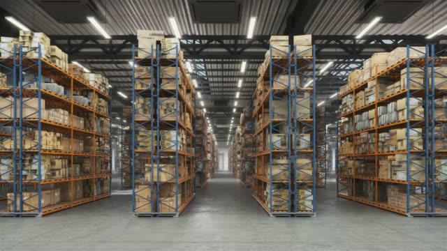 Horizontal camera move along the rows shelves with cardboard boxes. Industrial interior storage room.