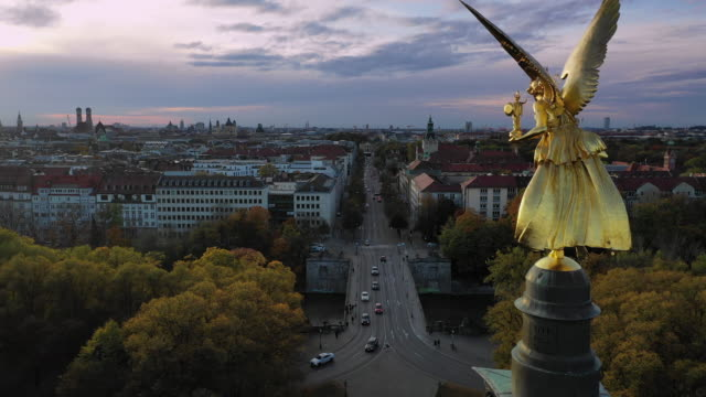 Horizontal pan - Autumn view over Munich, Germany, with Angel of Peace in foreground