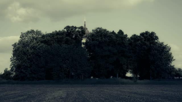 Horror scene at cemetery, graveyard. Scary, terrifying, depressing atmosphere.