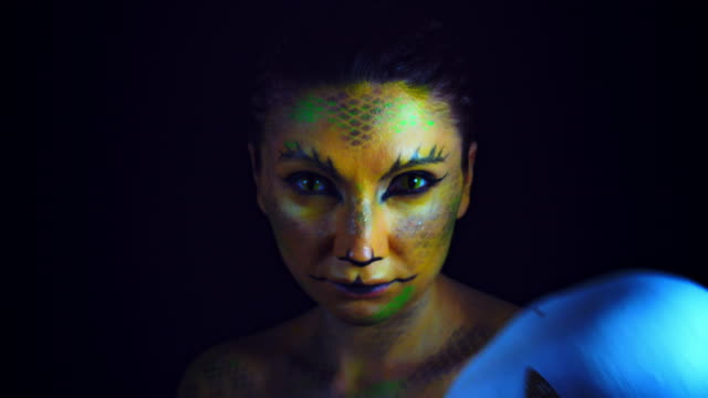 4k horror serpent makeup woman uncovers mask - ветхий завет стоковые видео и кадры b-roll