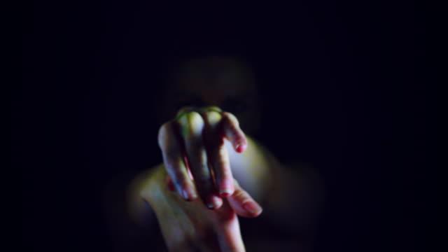 4k horror serpent woman gesturing with hands - ветхий завет стоковые видео и кадры b-roll