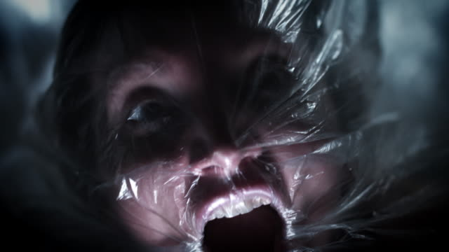 4K Horror Shot Of Woman Suffocating in Plastic Bag video