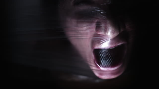 4K Horror Shot Of Woman Trying to Breath in Plastic Bag Caucasian actress performing. death stock videos & royalty-free footage