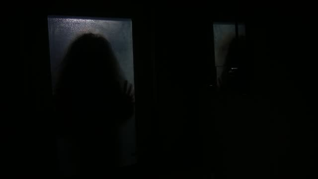 Horror silhouette of woman in window. Scary halloween concept Blurred silhouette of witch in bathroom Horror silhouette of woman in window. Scary halloween concept Blurred silhouette of witch in bathroom ghost stock videos & royalty-free footage