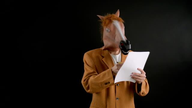 at kafa maskesi. - maske stok videoları ve detay görüntü çekimi