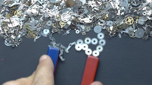 Horseshoe Magnet In Human Hand Writing Word SEO With Metal Clockworks On Blackboard video