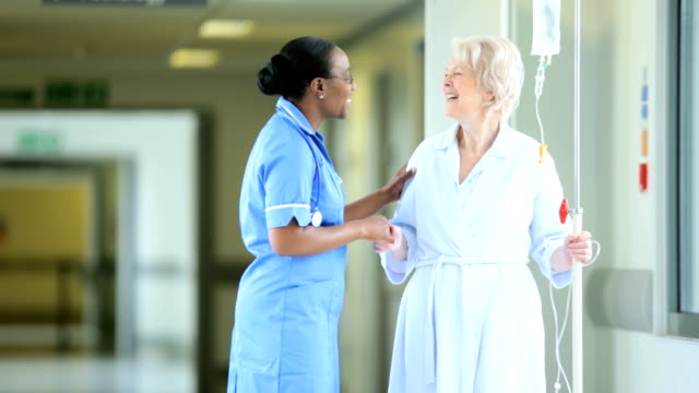 Hospital Corridor Ethnic Nurse Recovering Patient video
