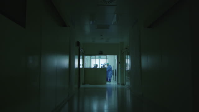Hospital Emergency Team Carrying Stretcher with Patient through Hospital Hall Hospital Emergency Team Carrying Stretcher with Patient through Hospital Hall stretcher stock videos & royalty-free footage