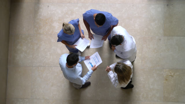 Video Hospital manager, nurses and doctors in a meeting at the hospital - High angle view