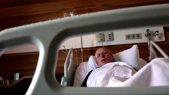 Hospital patient - an elderly man sleeps video