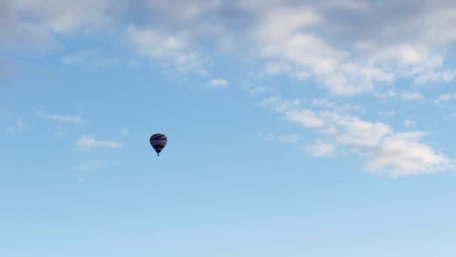 Hot air ballon fly on blue sky video