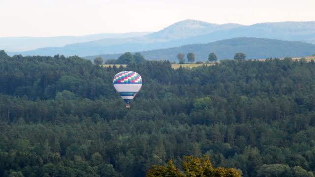 Hot air ballon fly over trees video