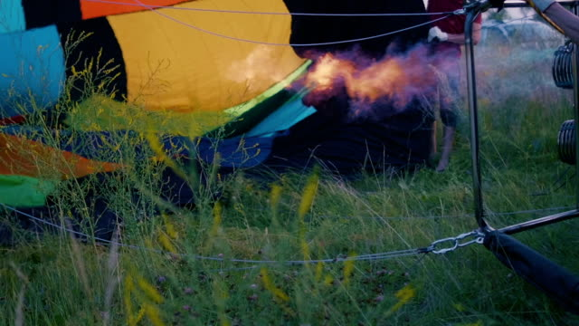 Hot air balloon burner firing and inflates the envelope video
