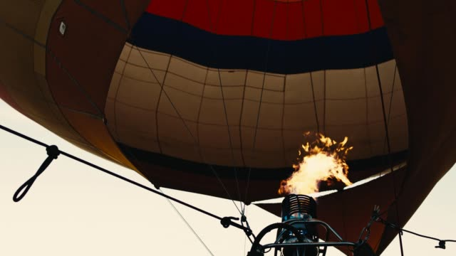 Hot air balloon. Fire bursts.Slow mo