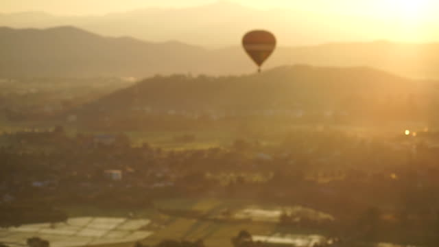 Hot air balloon flying at sunrise. video