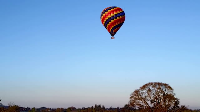 Hot air balloon flying far away video