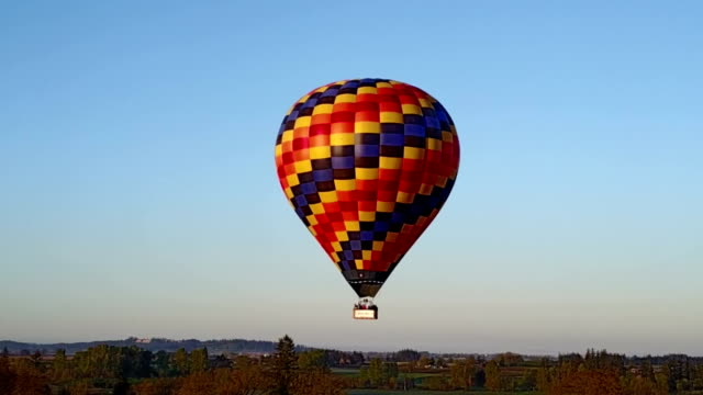 Hot air balloon flying in the rural area video