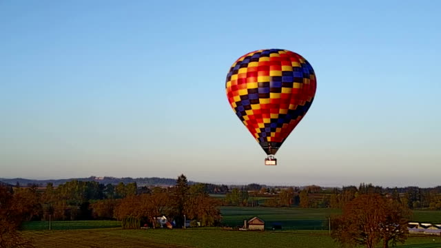 Hot air balloon flying over the farm video