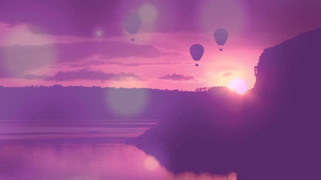 Hot air balloon flying with beautiful sunset