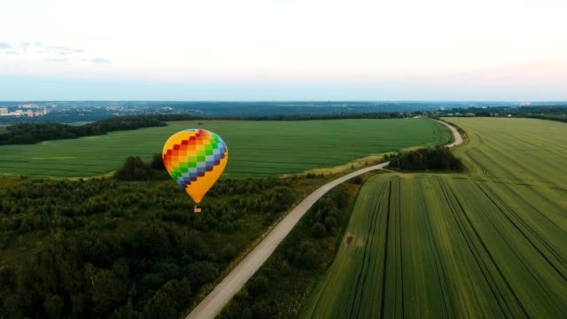 Hot air balloon in the sky over a field video