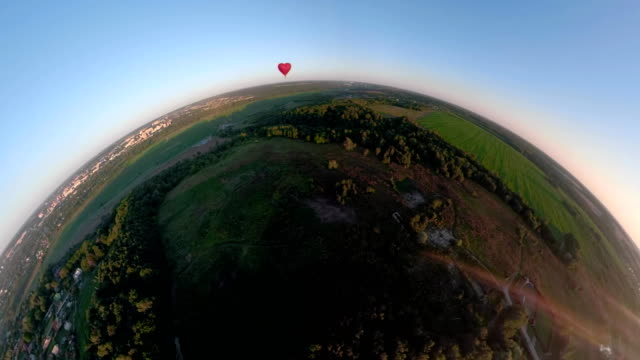 Hot air balloon in the sky over field spherical panorama video