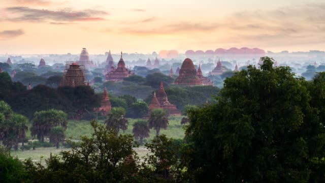 hot air balloon over plain of bagan in misty morning,magical sunrise over the temples in bagan, bagan myanmar - myanmar video stock e b–roll