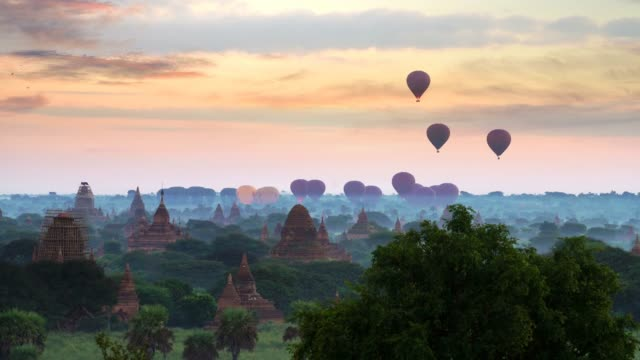 Hot air balloon over plain of Bagan in misty morning,Magical sunrise over the temples in Bagan, Bagan Myanmar Beautiful landscape view sunrise of pagoda with balloons in Bagan city, Myanmar. A romantic great place for travel. bagan stock videos & royalty-free footage