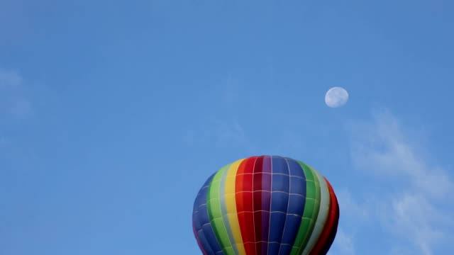 Hot Air Balloon Passes by the Moon video