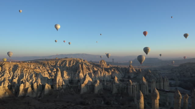 Hot air balloons Cave city in Cappadocia, Turkey Hot air balloons Cave city in Cappadocia, Turkey turkey stock videos & royalty-free footage
