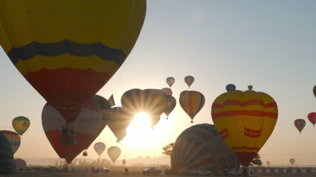 hot air balloons fly over mada'in saleh (hegra) ancient archeological site near al ula during the winter at tantora festival, january 3, 2020, saudi arabia - arabia saudita video stock e b–roll