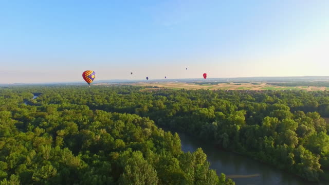 AERIAL Hot air balloons flying above the river video