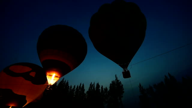 Hot air balloons get inflated with propane gas. video