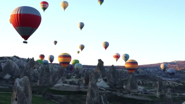 Hot air balloons in Cappadocia against blue sky in the early morning.