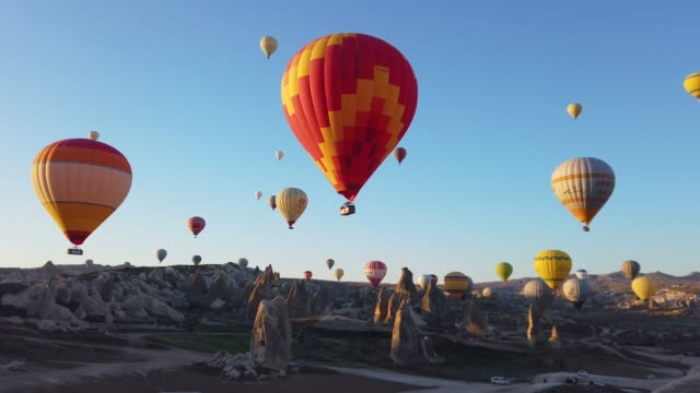 Hot Air Balloons in Cappadocia, Turkey Flying hot air balloons in early morning in Cappadocia saturated color stock videos & royalty-free footage