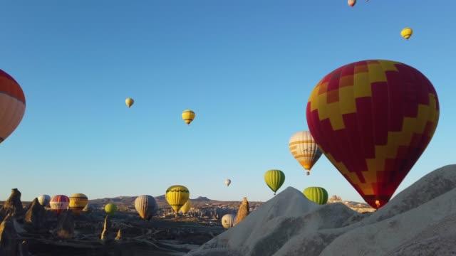 Hot Air Balloons in Cappadocia, Turkey Flying hot air balloons in early morning in Cappadocia hot air balloon stock videos & royalty-free footage