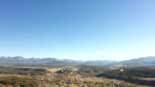 Hot Air Balloons in Distance Rising Above Small Colorado Town video