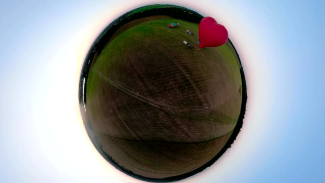 Hot air balloons in sky over field spherical panorama video