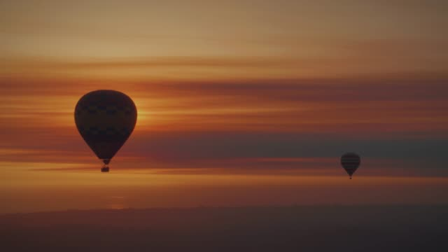 Hot Air Balloons in the Sunset Hot Air Balloons in the Sunset hot air balloon stock videos & royalty-free footage