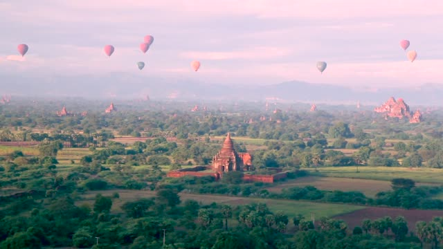 hot air balloons morning view of the temples of bagan myanmar - myanmar video stock e b–roll