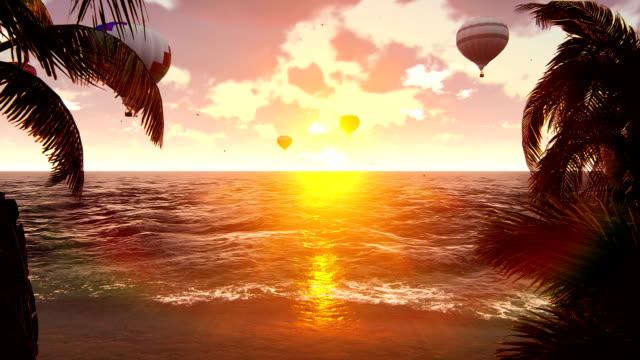 sıcak hava balonları batımında mavi deniz üzerinde. güzel yaz arka plan. - zeplin stok videoları ve detay görüntü çekimi
