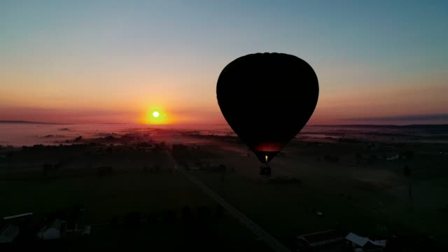 Hot Air Balloons Taking off on a Foggy Autumn Morning video