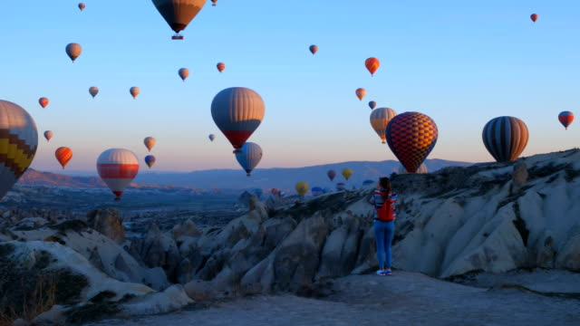 Hot air baloons preparing for take off. Famous sightseeing Cappadocia. Lights of air balloons.